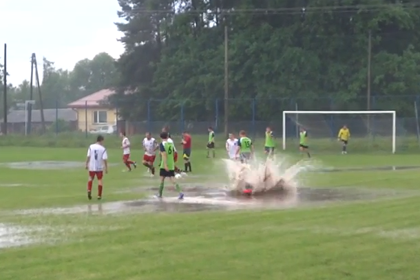 goal celebration jumps in puddle