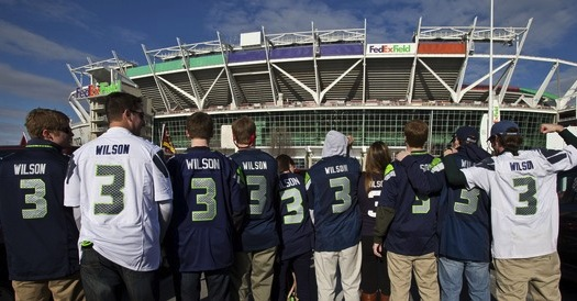 2 seahawks fans wearing russell wilson jerseys - top selling nfl jerseys
