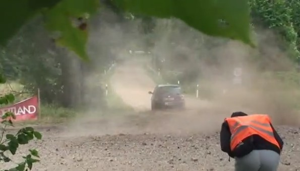 rally car worker debris to the groin