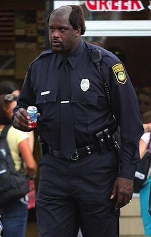 Shaq holding a soda can
