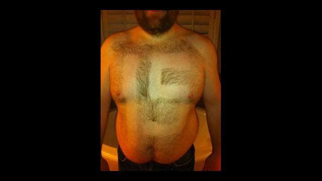 19 tebow fan - fans with signs shaved into their chest back hair