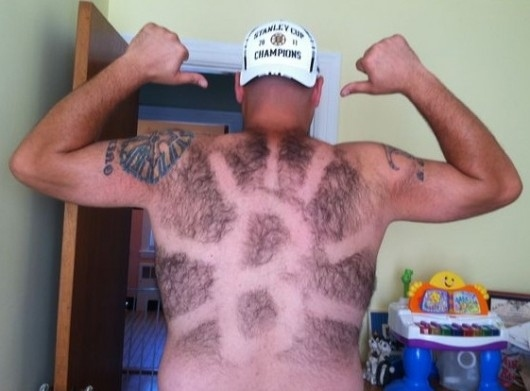 6 boston bruins fan - fans with signs shaved into their chest back hair