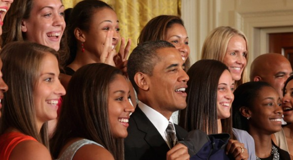 Lady Huskies give Obama bunny ears 1