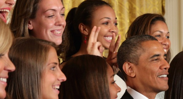 Lady Huskies give Obama bunny ears 2