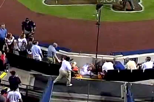 braves fan falls going for foul ball