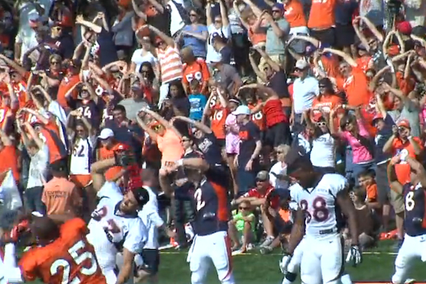 broncos fans stretch with team