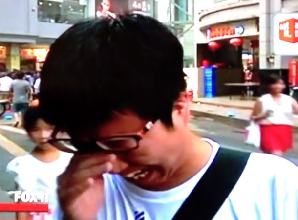 chinese man sobbing after seeing kobe bryant