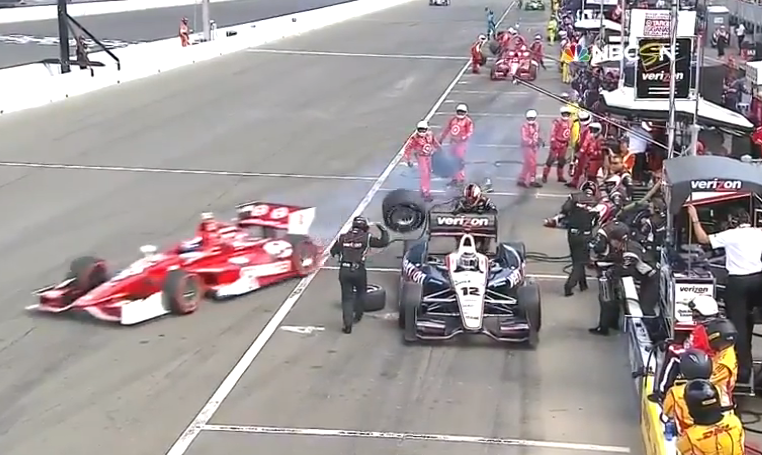 scott dixon takes out will power pit crew memeber