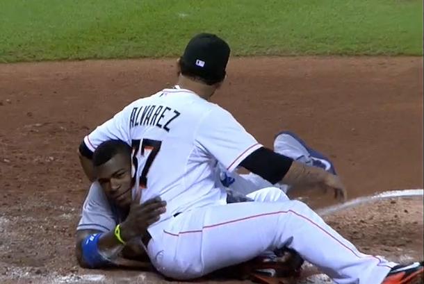 yasiel puig tries to take home on wild pitch