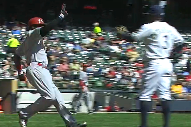 Brandon Phillips high fives Yuniesky Betancourt