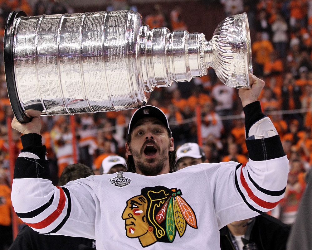 brent sopel hoisting cup - weird hockey injuries