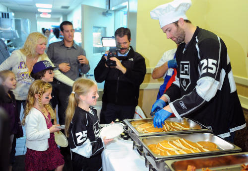 dustin penner serving pancakes for charity - weird hockey injuries