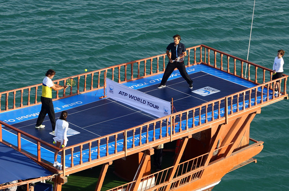 21 nadal and federer atop of dhow (boat) on doha bay in qatar (2009) - weird sports venues
