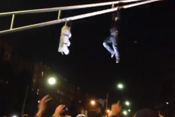 boston fans climb traffic lights