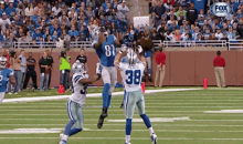 While Dez Bryant Was Busy Yelling, Calvin Johnson Was Busy Catching 14 Passes for 329 Yards (GIFs)