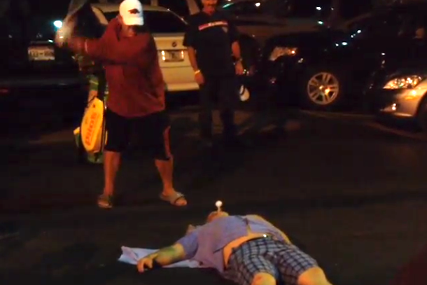 john daly hits golf ball out of dudes mouth in parking lot