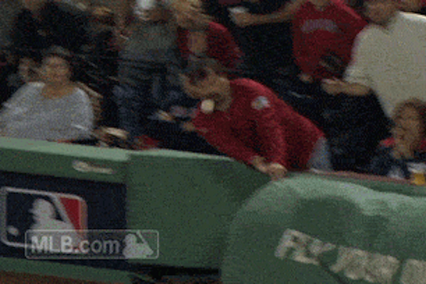 red sox fan takes foul ball to face