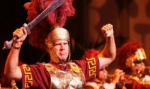 Here's Will Ferrell, Dressed as a Trojan While Conducting the USC Marching Band (Video)