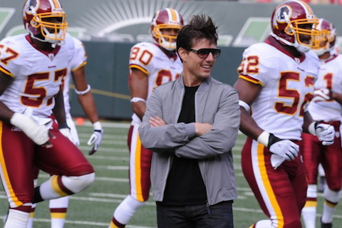 Redskins fan Tom Cruise on field with team