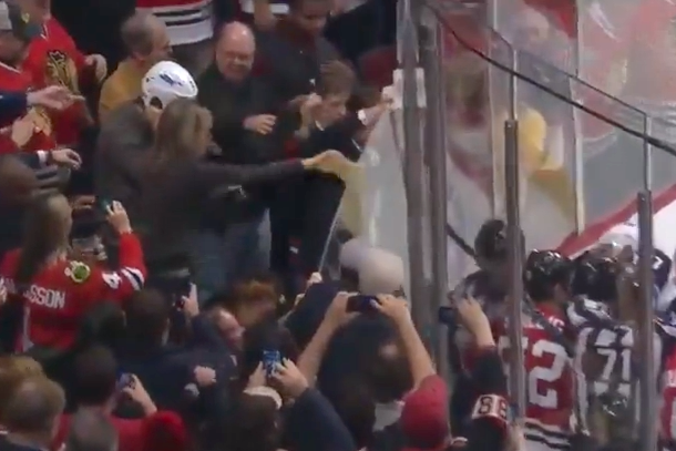 blackhawks fan dumps beer on jets player