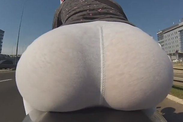 gopro cam woman in yoga pants on motorcycle
