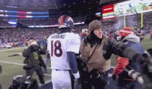 Photographers Fight During Postgame Handshake Between Peyton Manning and Tom Brady  (GIF)