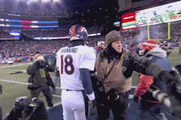 photographers fight over manning brady handshake (photographer fight)
