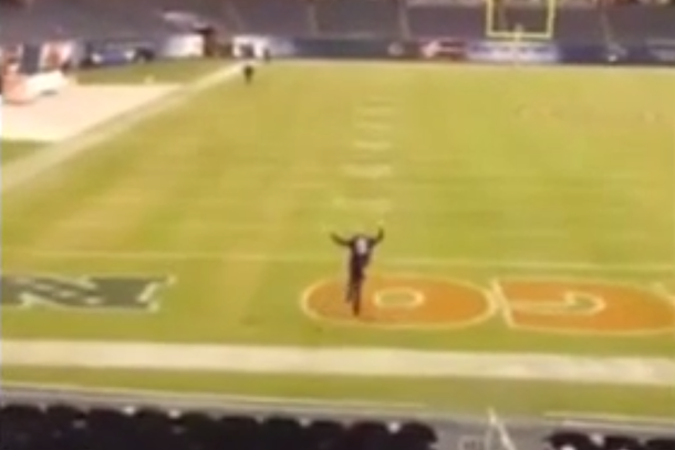 ravens fan runs onto field at soldier stadium during rain delay