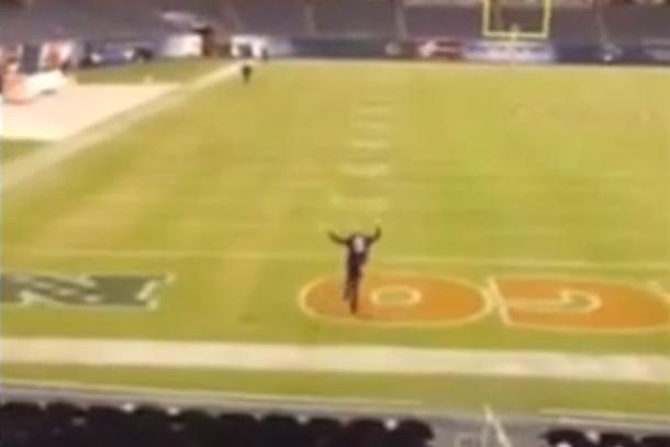 ravens fan runs onto field at soldier stadium during rain delay