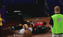 Vikings-Redskins Game Ends with Santana Moss Taking Out Cameraman (GIF)