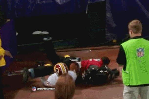 santana moss takes out cameraman on last play of game
