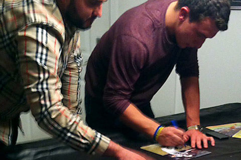14 Johnny Manziel signing autographs for money - athletes of santa's naughty list 2013