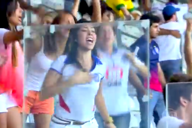 female soccer fans celebrates by lifting shirt