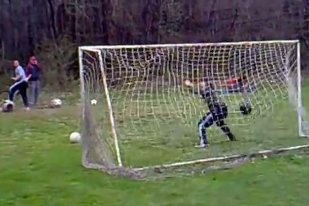 goalie practices penalty kicks with cannon