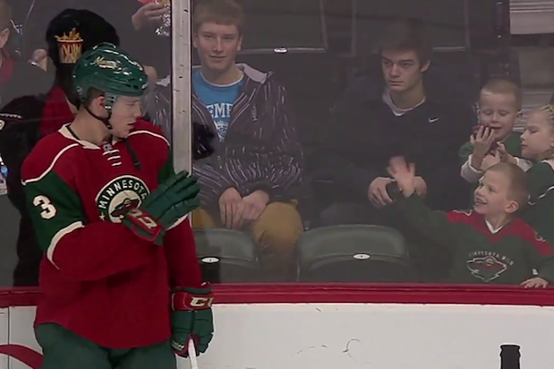 hockey player charlie coyle waves at little boy