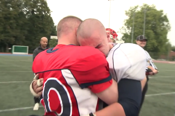 military father surprises son at football game