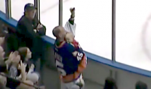 Hockey Fan Catches Puck in One Hand While Holding Sleeping Infant in the Other (Video)