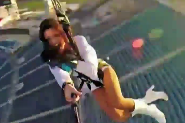 jaguars cheerleader ziplining over stadium