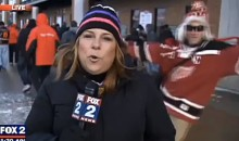 Videobombing Fail: Red Wings Fan Gets Taken Out by Icy Patch at Winter Classic (Video)