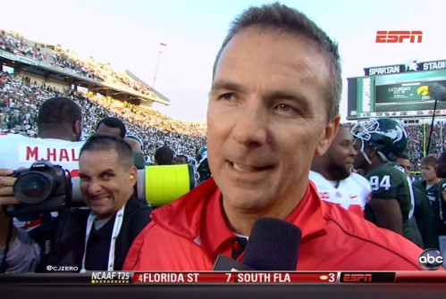 36 urban meyer photobombed by photographer