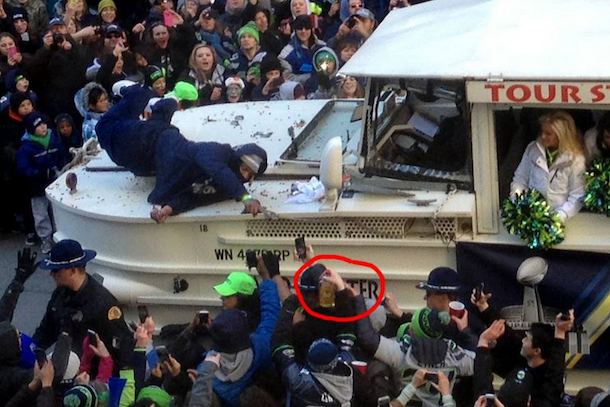 Marshawn Lynch reaching for bottle of fireball