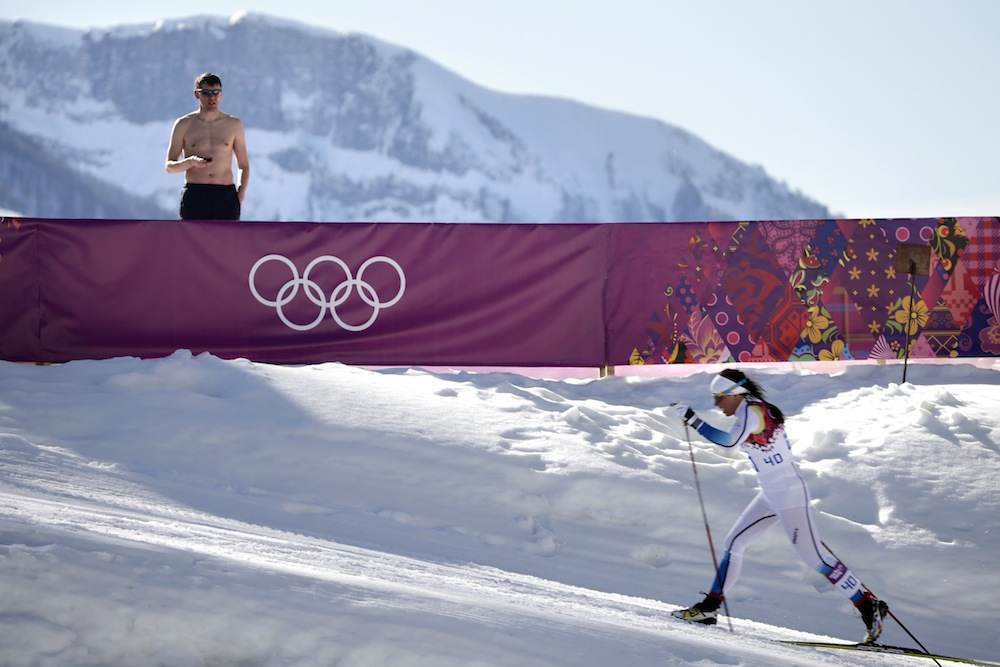 Shirtless man watches cross-country in Sochi