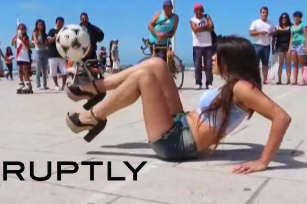 argentine model juggles soccer ball in high heels