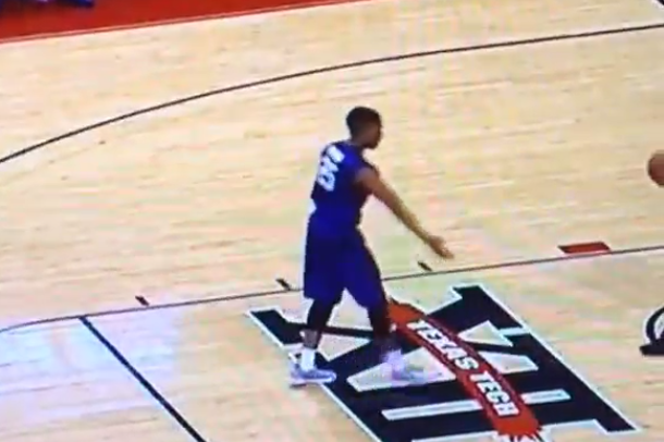 k-state player high fives imaginary teammates