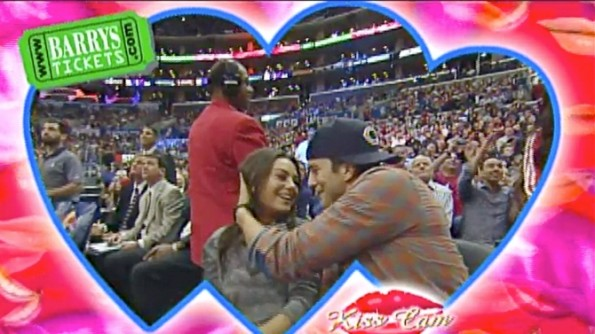 Ashton Kutcher and Mila Kunis on the Kiss Cam