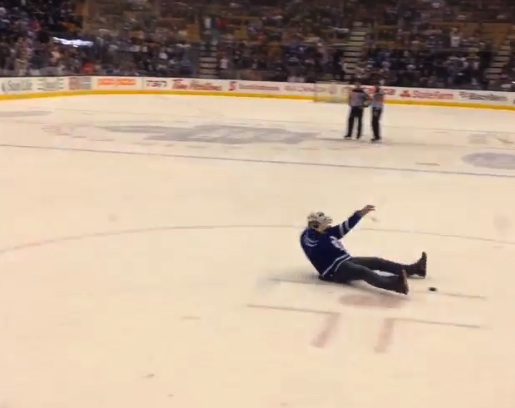 drunk fan runs onto ice during leafs lighting hockey game at acc