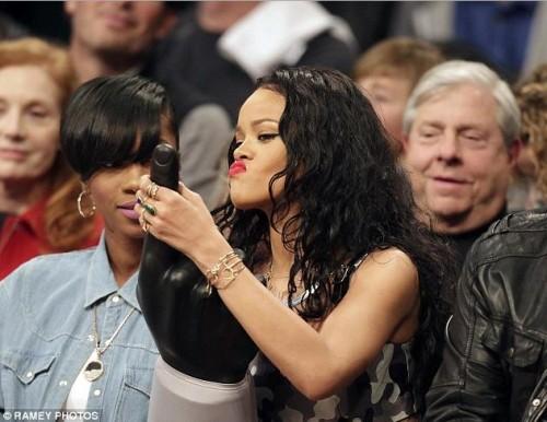 Rihanna Uses Giant Foam Finger to Entertain Old White Men (2)