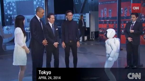Barack Obama Plays Soccer with a Robot