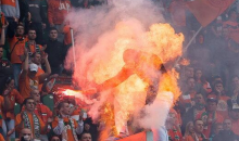 Security Tries To Extinguish Flare Held By Polish Soccer Fan, Set Him Ablaze Instead (Video)