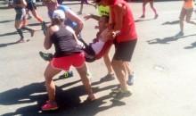 Collapsed Runner Carried Across Boston Marathon Finish Line by Fellow Runners